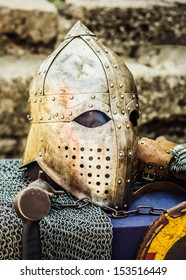 Protective helmet with a visor on medieval knight. Medieval Templar helmet waiting for knight