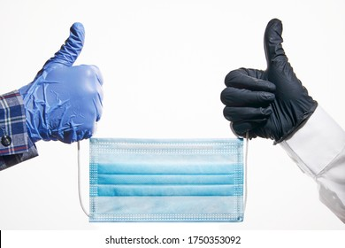Protective latex gloves and a one-time mask symbol of modern times