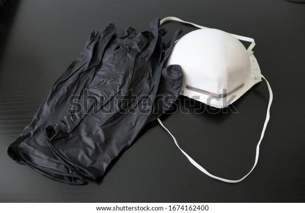 protective-mask-gloves-on-black-600w-167