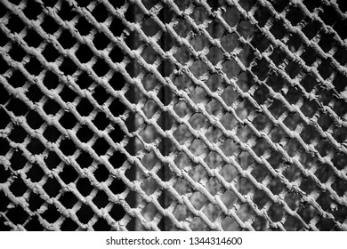 Protective old metal gratings or grille on the basement window of  residential building or house