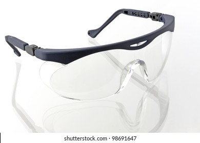 A protective plastic glasses on a white background into.