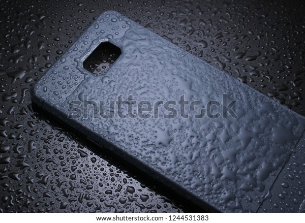 Protective smartphone case with water drops on black background