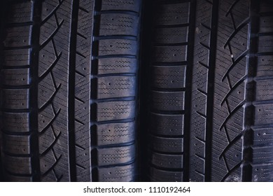 Protector of automobile tires. A number of automobile tires. Close up view on auto mobile new wheel tire surface.