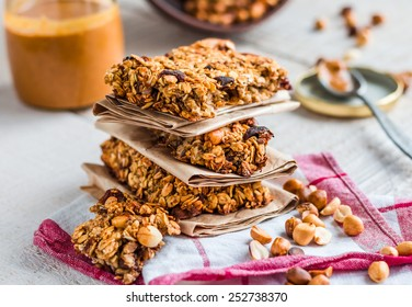 protein bars granola with seeds, peanut butter and dried fruit, healthy snack on wooden background