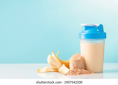 Protein sport shake, banana and powder . Fitness food and drink. Diet