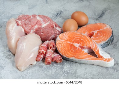 Proteins and fats. Pork, chicken, bacon, eggs, fish salmon. Healthy food, keto ketogenic diet Raw products ingredients