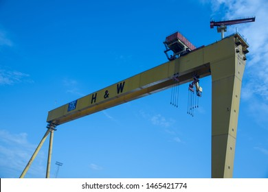Protest at Harland and wolff Belfast, 30th July 2019: Workers at the famous Harland and Wolff Ship Yard, where the Titanic was built,display a banner over crane, to save the ship yard from closure