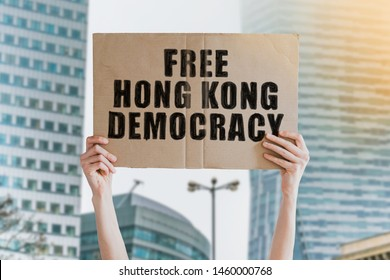 Protest in Hong Kong. Protestor holds a cardboard with an inscription: Free Hong Kong Democracy