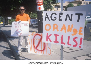 Protester against agent orange chemicals holding signs