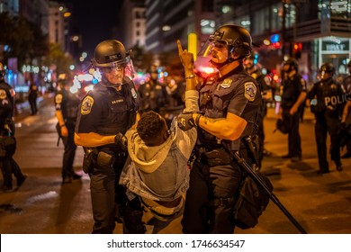 A protester is being taken by policemen. Many protesters gathered around in front of White House in Washington DC on 5/30/2020.