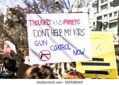 Protester carrying a sign at the March for Our Lives demonstration. Supporters marched to Seattle Center demanding action on gun control. Seattle, WA, March 24, 2018.