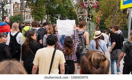 A protester holds a banner over his head. Protesters march in the city center. Crowd with young activists. Students' peaceful, political protest. Moscow,Russia,AUGUST,31,2019.