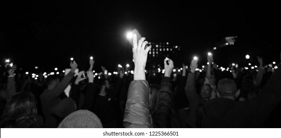 Protester holds light