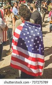 Protester wrapped in flag at Pro and Anti Trump rally , Provo Park , Berkeley Ca , April 16th  2017