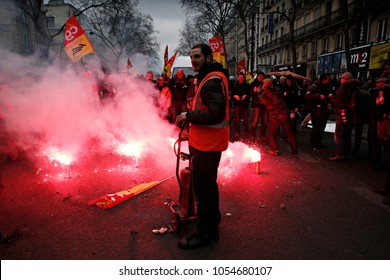 Protesters of the French General Confederation of Labour union light flares during a demonstration during a national day of strike against reforms in Paris, France on Mar. 22, 2018