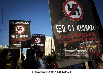 Protesters are holding anti-fascist placards during the protest against the far- right party Golden Dawn in Athens, Greece, on the 25th of September 2013.