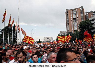Protesters holding a Macedonian flag and banners during a protest against Prime Minister Nikola Gruevski as they march towards the offices of government in Skopje, Macedonia on May 17,2015