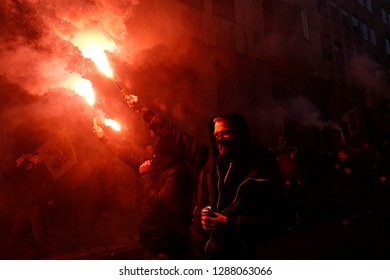 Protesters of right-wing and far-right Flemish associations light up flares during a protest against Marrakesh Migration Pact in Brussels, Belgium on Dec. 16, 2018.