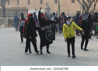 Protesters rises flages during Clashes Between protesters and govt forces after friday prayers at jamia masjid srinagar 30 November 2018.