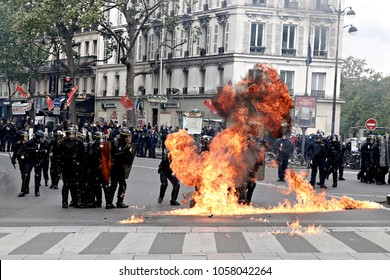 Protesters throw petrol bomb to riot police during a march for the annual May Day workers' rally in Paris, France on May 1, 2017.