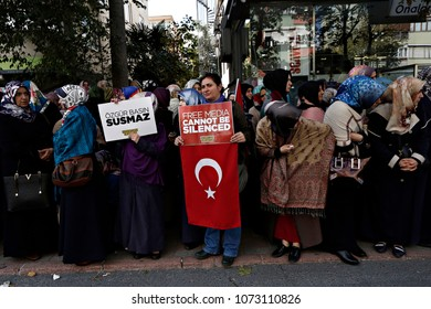 Protesters wave flags and chant slogans as they surround the headquarters of a media company linked to a government critic, enforcing a court order to seize the business, in Istanbul, Oct. 28, 2015.