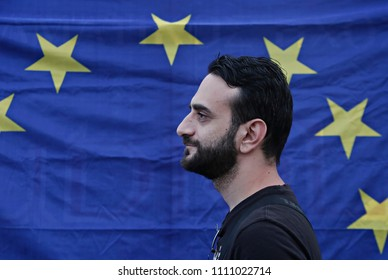 A protestor walks in front of an EU flag during a pro-European Union demonstration in Thessaloniki,  Greece on June 22, 2015