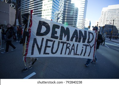 Protestors advocating for net neutrality rally on the streets of Philadelphia, Saturday, January 13, 2018.
