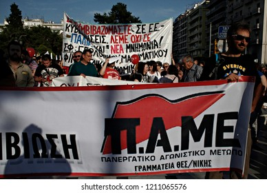 Protestors chant slogans as they hold placards during  a march against the government's austerity politics in Thessaloniki, Greece, on June 11, 2015 - Shutterstock ID 1211065576