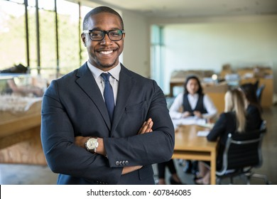 Proud accomplished portrait of business man team leader smiling with arms crossed