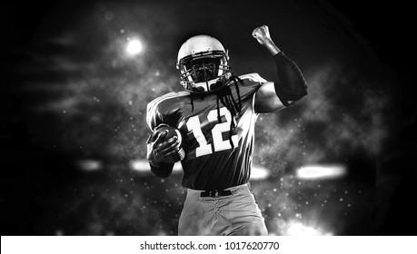 Proud american football player in dark