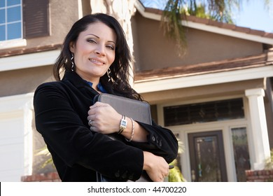 Proud, Attractive Hispanic Real Estate Agent Woman in Front of New Home.