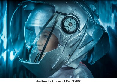 Proud, Boy playing to be an astronaut with space helmet and metal suit