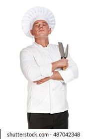 Proud chef man holding two knifes.