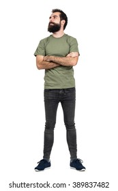 Proud confident bearded man with crossed arms looking up. Full body length portrait isolated over white studio background.