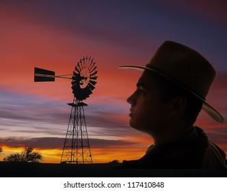Proud farmer at sunset