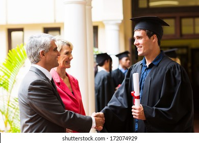 proud father congratulating his son on graduation day