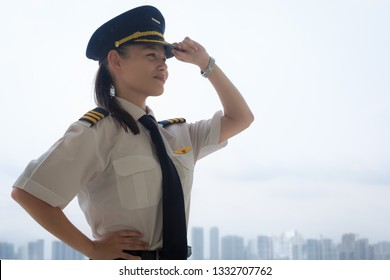Proud female pilot at the airport.