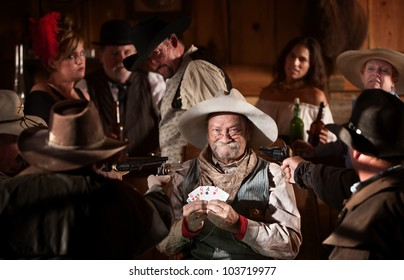 Proud gambler holds winning cards with jealous players