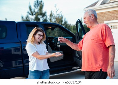 Proud grandfather gives present to his granddaughter a brand new american truck, her first driving lessons class, growing up teenager