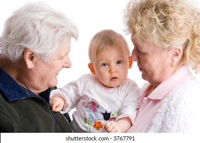 proud grandparents are carrying their cute granddaughter