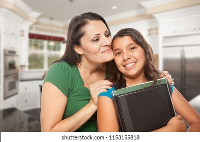 Proud Hispanic Mother and Daughter In Kitchen at Home Ready for School.
