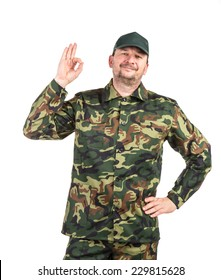 Proud man in military suit. Located on a white background.