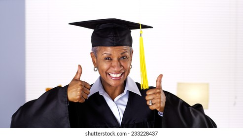 Proud mature African woman graduate