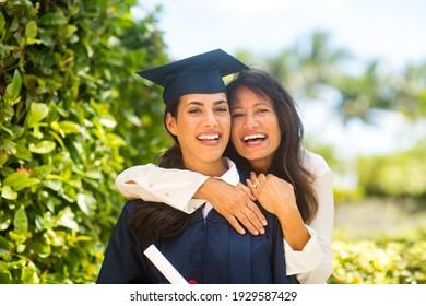 Proud mother hugging her daugher at her graduation