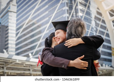 Proud parents congratulate her daughter, who finish their studies at the university ceremony