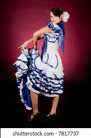 Proud pose of a young Spanish flamenco dancer