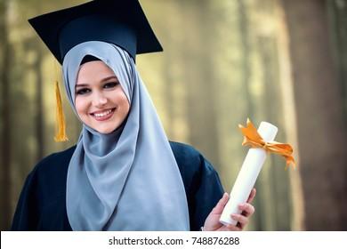 proud pretty muslim girl graduation, holding diploma, happy concept