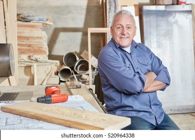 Proud senior citizen as excecutive chief at carpentry shop