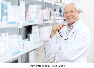 Proud small business owner. Portrait of a happy senior man pharmacist posing confidently and proudly in his pharmacy store smiling joyfully copyspace business businessman profession doctor concept
