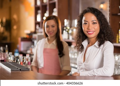 Proud small business owner smiling at camera
